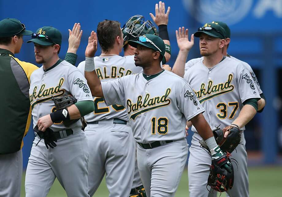 Alberto Callaspo (No. 18) had the big hit in the A's win; he's 5-for-13 after going hitless in his first 11 at-bats for Oakland. Photo: Tom Szczerbowski, Getty Images