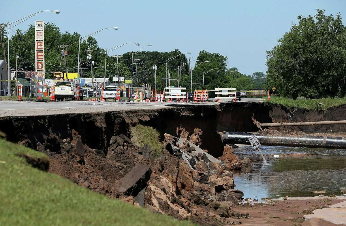 Flash flooding leaves a massive sinkhole on Route 62 June 2, 2013 in Oklahoma City, Oklahoma. A series of tornadoes ripped through the area on the evening of March 31st causing flash flooding, killing at least nine people, injuring many others and destroying homes and buildings.