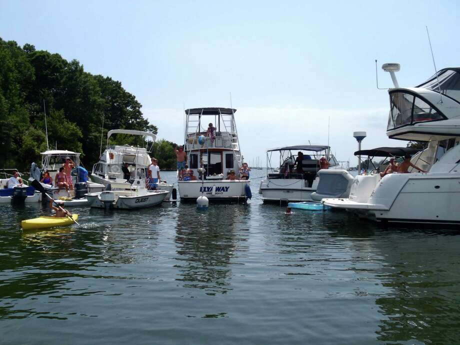 This photograph taken by Greenwich Harbormaster Ian MacMillan shows several boats around the mooring of former Greenwich police officer Peter Silbereisen on Sunday August 11, 2013. Some Windrose Way residents, who maintain the channel where the mooring is located, say it is difficult to navigate the channel when Silbereisen and others congregate at the mooring. Photo: Contributed Photo / Greenwich Time Contributed