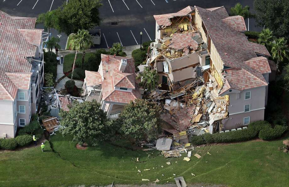 Guests had only 10 to 15 minutes to escape the collapsing building at the Summer Bay Resort, located about 7 miles east of Walt Disney World resort, when a sinkhole about 60 feet in diameter and 15 feet deep opened. Photo: Red Huber, MBR / Orlando Sentinel