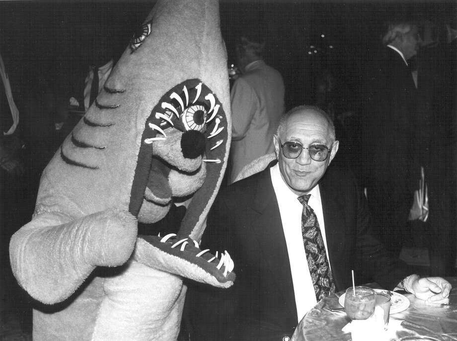 "The Spurs Coyote dressed as a shark for new coach Jerry ""Tark the Shark"" Tarkanian's (right) welcoming reception at the Marriott Riverwalk on June 19, 1992. Photo: San Antonio Express-News"