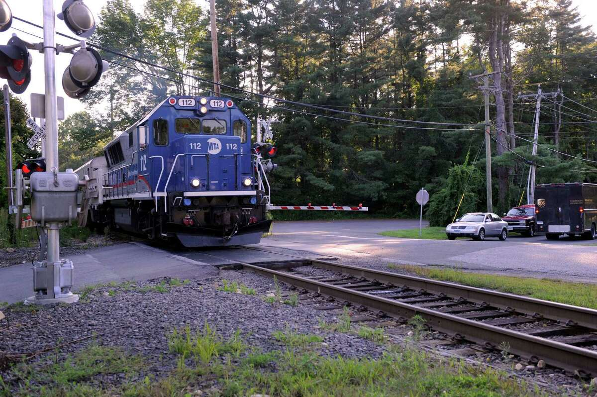 Protective gates are now in place at the Long Ridge Road railroad crossing in West Redding, Conn., where two people lost their lives and two others were injured last December. Monday, August 12, 2013.