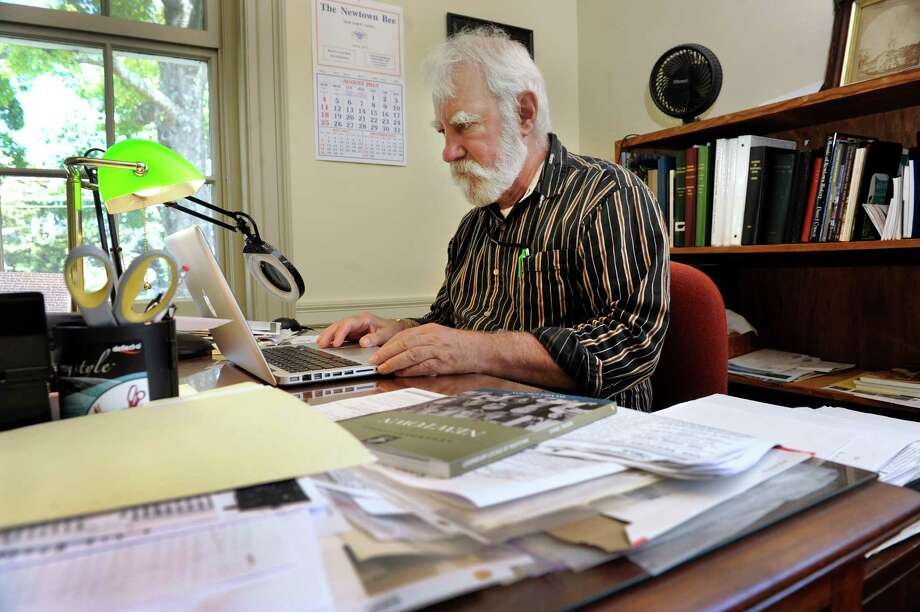 Town Historian Dan Cruson, 68, has written a book about the people of Newtown, including a special tribute to those lost in the shooting tragedy at Sandy Hook. He is photographed in his office at the Edmond Town Hall, in Newtown, Conn., Monday, Aug. 5, 2013. Photo: Carol Kaliff / The News-Times