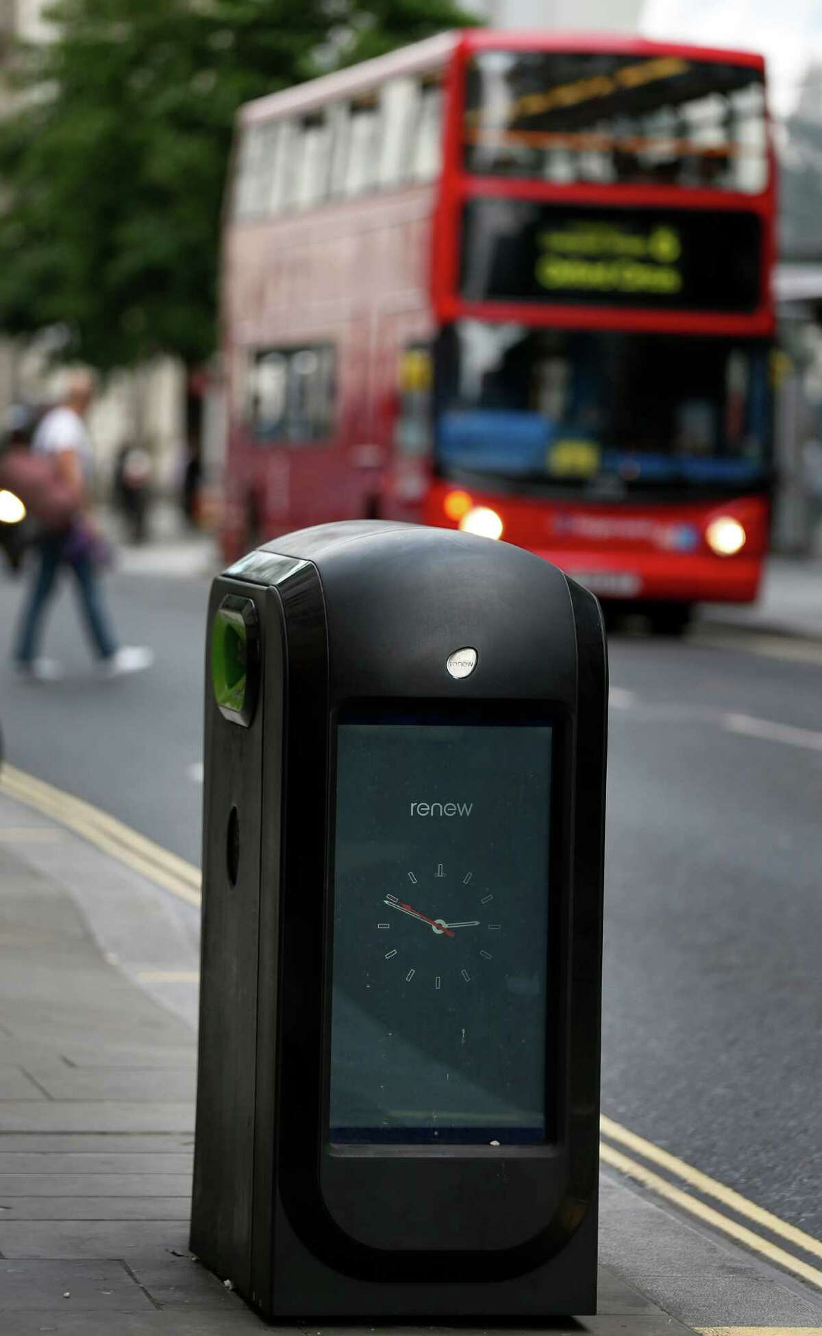 A trash bin is seen in central London, Monday, Aug. 12, 2013. Officials say that an advertising firm must immediately stop using its network of high-tech trash cans, like this one, to track people walking through London's financial district.The City of London Corporation says it has demanded Renew pull the plug on the program, which measures the Wi-Fi signals emitted by smartphones to follow commuters as they pass the garbage cans. The City of London Corporation is responsible for the city's historic