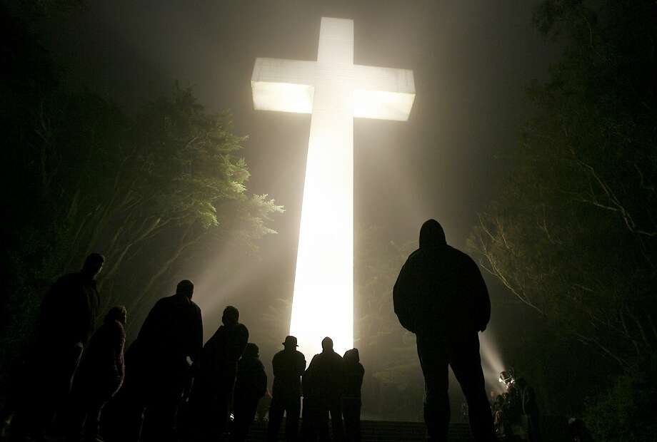 Even before sunrise, the faithful gathered, as dozens of lights lit the cross and the fog rolled over the mountain. The 85th annual sunrise service at Mt. Davidson Cross was held Sunday morning in the fog and wind. Several hundred gathered under the huge cross for the annual Easter service in 2007. Photo: Brant Ward, The San Francisco Chronicle