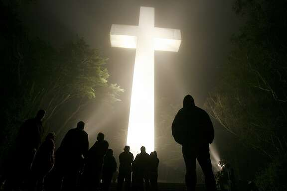 Even before sunrise, the faithful gathered, as dozens of lights lit the cross and the fog rolled over the mountain.  The 85th annual sunrise service at Mt. Davidson Cross was held Sunday morning in the fog and wind. Several hundred gathered under the huge cross for the annual Easter service.  April 9, 2007