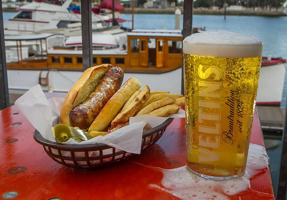 Brotzeit Boathaus and Biergarten on the waterfront in Oakland offers a casual, friendly vibe and has 15 beers on tap, mostly German varieties, like the Veltins Pilsner. Photo: John Storey, Special To The Chronicle