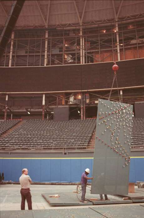 Paul Darst, former operator of the Astrodome's electronic scoreboard, watches as workers dismantle the Houston landmark in 1988.  Photo: STEVE UECKERT, © Houston Chronicle / HOUSTON CHRONICLE