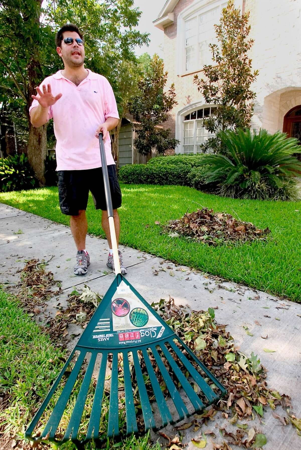 No. 8: West University Place, Texas WEST UNIVERSITY, TX - SEPTEMBER 25: David Frankfort, a resident of West University, Texas, rakes outside his home on September 25, 2005. He had to sit in seven hours of traffic congestion, before he could reach Austin, Texas - a city outside the path of Hurricane Rita. More than 2 million Houston-area residents evacuated their city. (Photo by Melanie Stetson Freeman/The Christian Science Monitor via Getty Images)