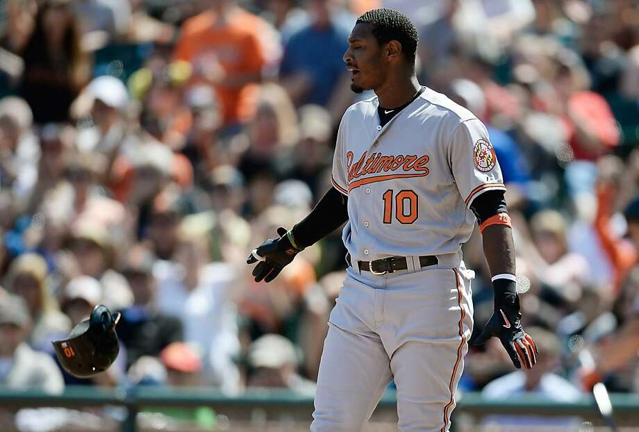 Adam Jones of the Baltimore Orioles reacts and tosses his helmet away in frustation after striking out for the final out of the sixth inning against the San Francisco Giants at AT&T Park on August 11, 2013 in San Francisco, California. Photo: Thearon W. Henderson, Getty Images