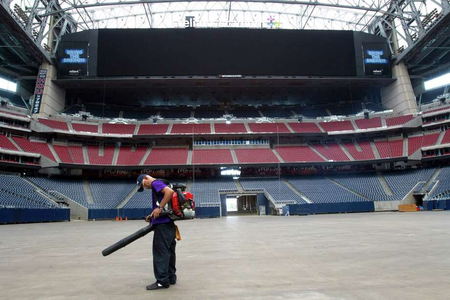 New 277-foot-long video boards grace each end zone of Reliant Stadium, being readied for Saturday's NFL exhibition. Photo: Brett Coomer, Staff / © 2013 Houston Chronicle