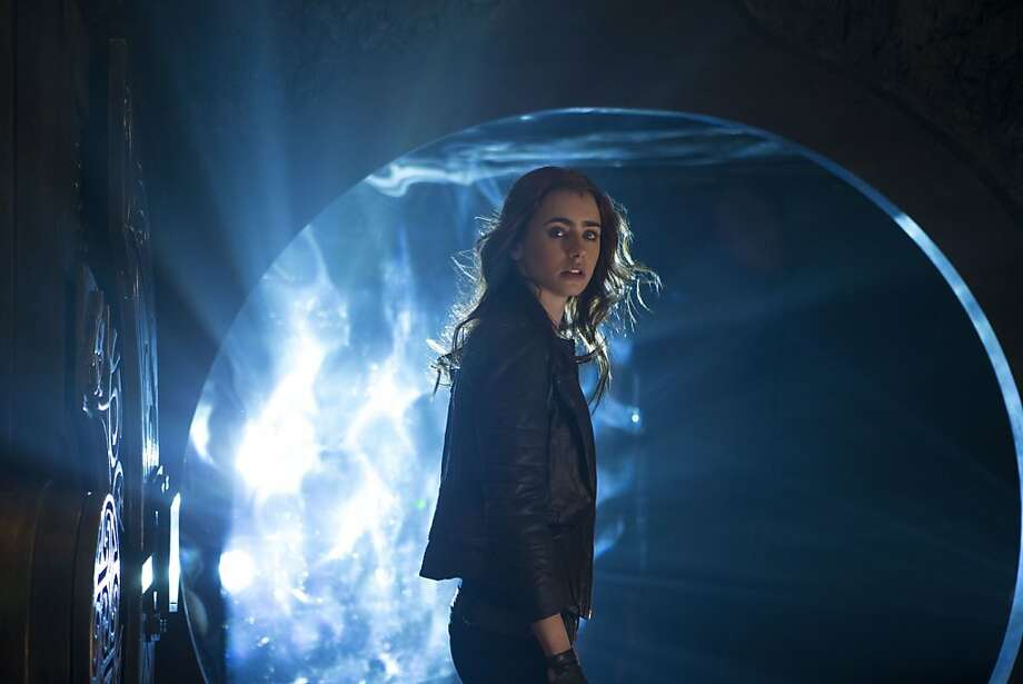 """Lily Collins plays Clary in """"The Mortal Instruments: City of Bones,"""" the film adaptation of the first in a series of five books by Cassandra Clare. Photo: Rafy, Sony Pictures"""