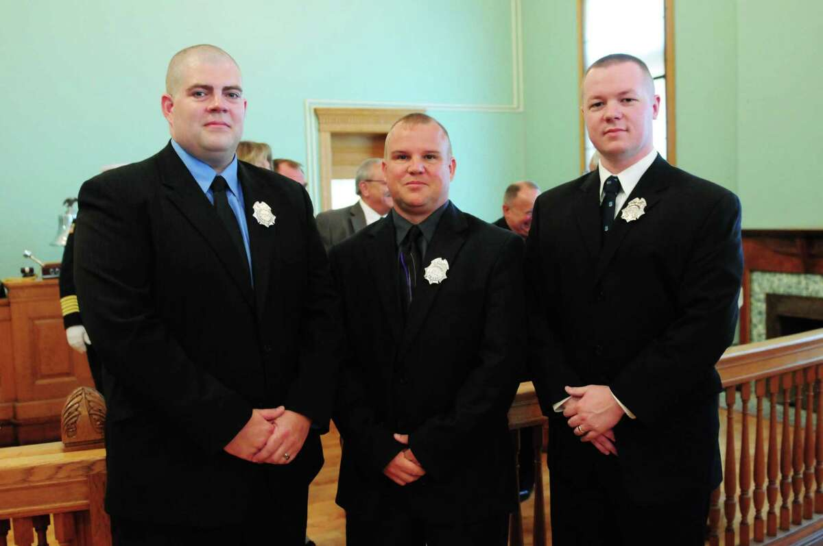 Niklas Erickson, left, Brian Bullock, and Peter Annely, right, were sworn in as Cohoes firefighters Monday morning, Aug. 12, 2013, during a ceremony at City Hall in Cohoes, N.Y. The three Cohoes residents will bring department staffing up to 32 firefighters. They will now head to Utica where they'll attend the firefighting academy. (Will Waldron/Times Union)