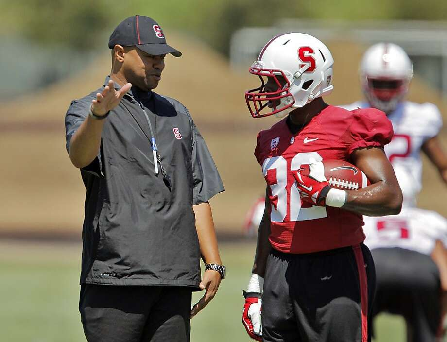 Stanford head coach Davis Shaw speaks with Anthony Wilkerson, back for his senior season. Photo: Carlos Avila Gonzalez, The Chronicle