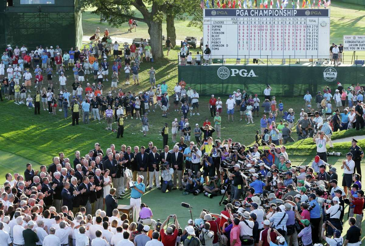 Jason Dufner, at center, holds up the Wanamaker Trophy after winning the PGA Championship golf tournament at Oak Hill Country Club, Sunday, Aug. 11, 2013, in Pittsford, N.Y. (AP Photo/Patrick Semansky) ORG XMIT: NYPM211