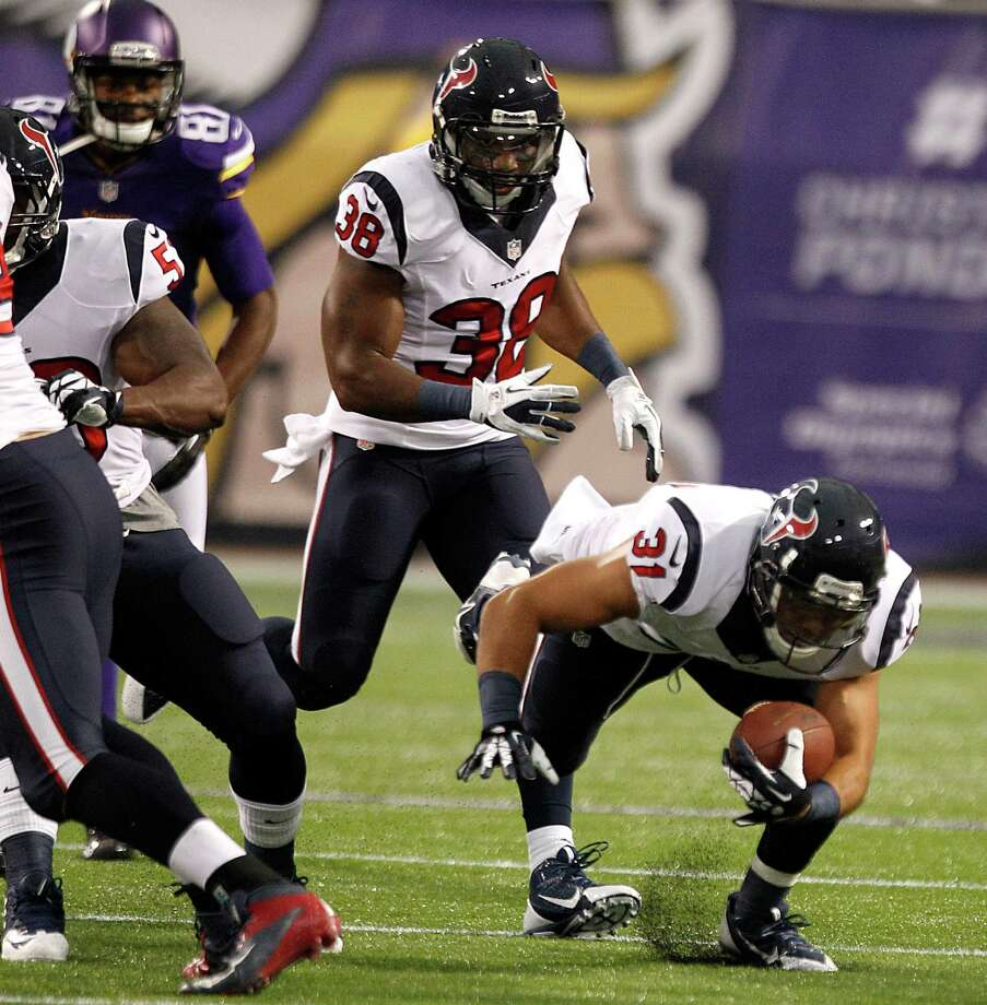 Texans safety Shiloh Keo (31) returns an interception early in the first preseason game against the Minnesota Vikings on Friday night. Photo: Brett Coomer, Staff / © 2013  Houston Chronicle