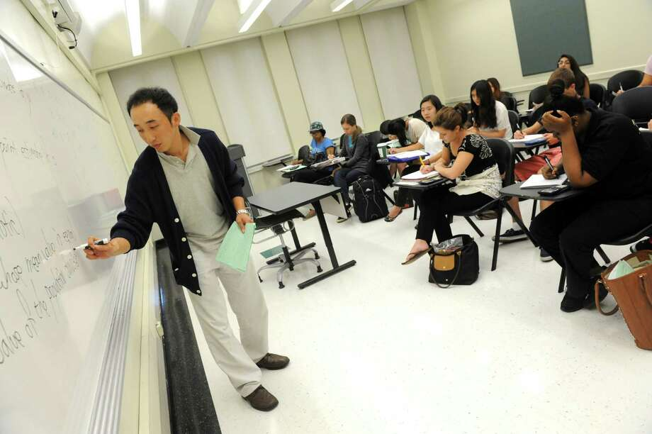 Professor Jae Yong Choi teaches a class on statistics Tuesday afternoon, Aug. 6, 2013, at the University at Albany in Albany, N.Y. (Michael P. Farrell/Times Union) Photo: Michael P. Farrell / 00023438A