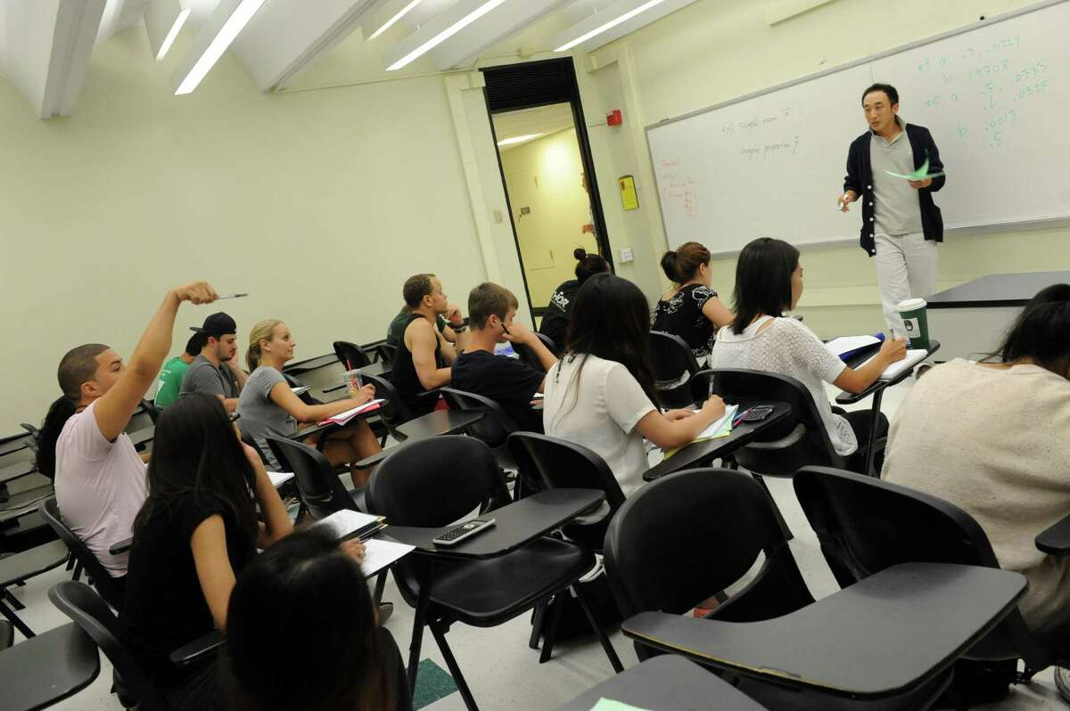 Professor Jae Yong Choi, right, teaches a class on statistics Tuesday afternoon, Aug. 6, 2013, at the University at Albany in Albany, N.Y. (Michael P. Farrell/Times Union)