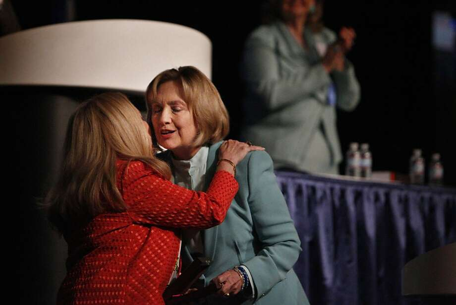 Hillary Clinton (right) embraces American Bar Association President Laurel Bellows. Clinton's speech touched off speculation that she's embarking on a campaign for president. Photo: Lea Suzuki, The Chronicle