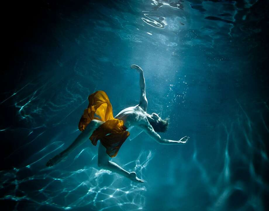 "Ian Smith dances underwater for a film in Capacitor's dance/cirque experience ""Okeanos Intimate"" a love letter to the sea: portrait of the ocean as body, environment, resource, metaphor, and force. The show has been extended through the end of the year. Photo: Joseph Seif Photograghy"