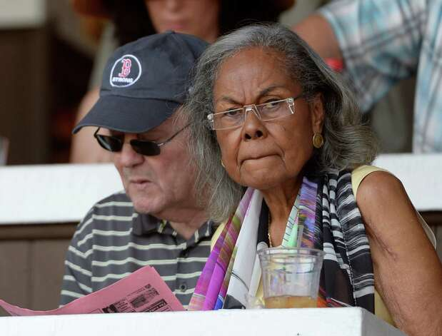 Rachel Robinson, wife of former major leaguer and Hall of Famer Jackie Robinson, checks out the horses as they parade to post for the second race Monday morning, Aug. 12, 2013, at Saratoga Race Course in Saratoga Springs, N.Y. Seated with Robinson is friend Alan Zura. (Skip Dickstein/Times Union) Photo: SKIP DICKSTEIN