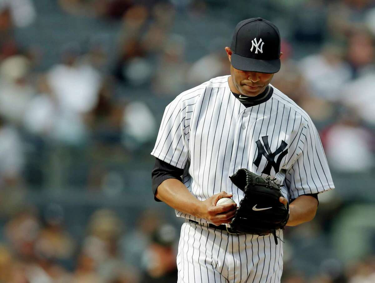 New York Yankees relief pitcher Mariano Rivera reacts on the mound after allowing consecutive home runs in the ninth-inning of the Yankees 5-4 victory over the Detroit Tigers in a baseball game, Sunday, Aug. 11, 2013, in New York. (AP Photo/Kathy Willens) ORG XMIT: NYY221