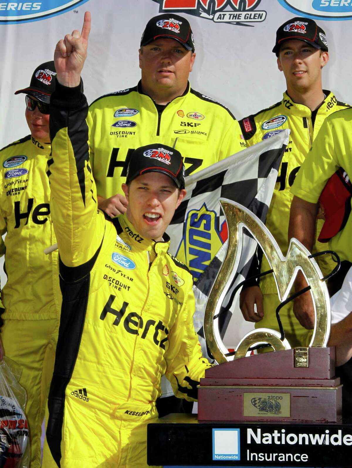 Brad Keselowski celebrates in Victory Lane after winning the NASCAR Nationwide Series auto race, Saturday, Aug. 10, 2013, in Watkins Glen, N.Y. (AP Photo/Russ Hamilton Sr.) ORG XMIT: NYME115