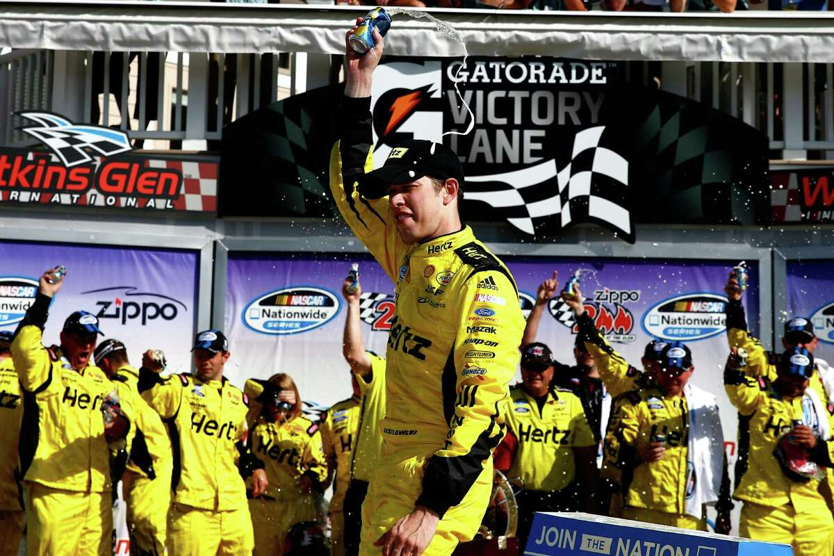 WATKINS GLEN, NY - AUGUST 10: Brad Keselowski, driver of the #22 Hertz Ford, celebrates in victory lane after winning the NASCAR Nationwide Series Zippo 200 at Watkins Glen International on August 10, 2013 in Watkins Glen, New York. (Photo by Tom Pennington/Getty Images) ORG XMIT: 175939315