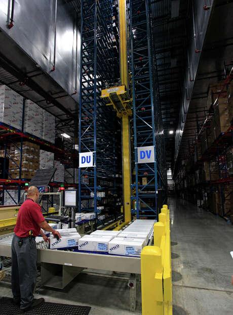 Mini-loader operator Mark Estrada works in the 630,000-square-foot Sysco distribution center outside San Antonio. Sysco is based in Houston. Photo: J. Michael Short, Freelancer / The San Antonio Express-News