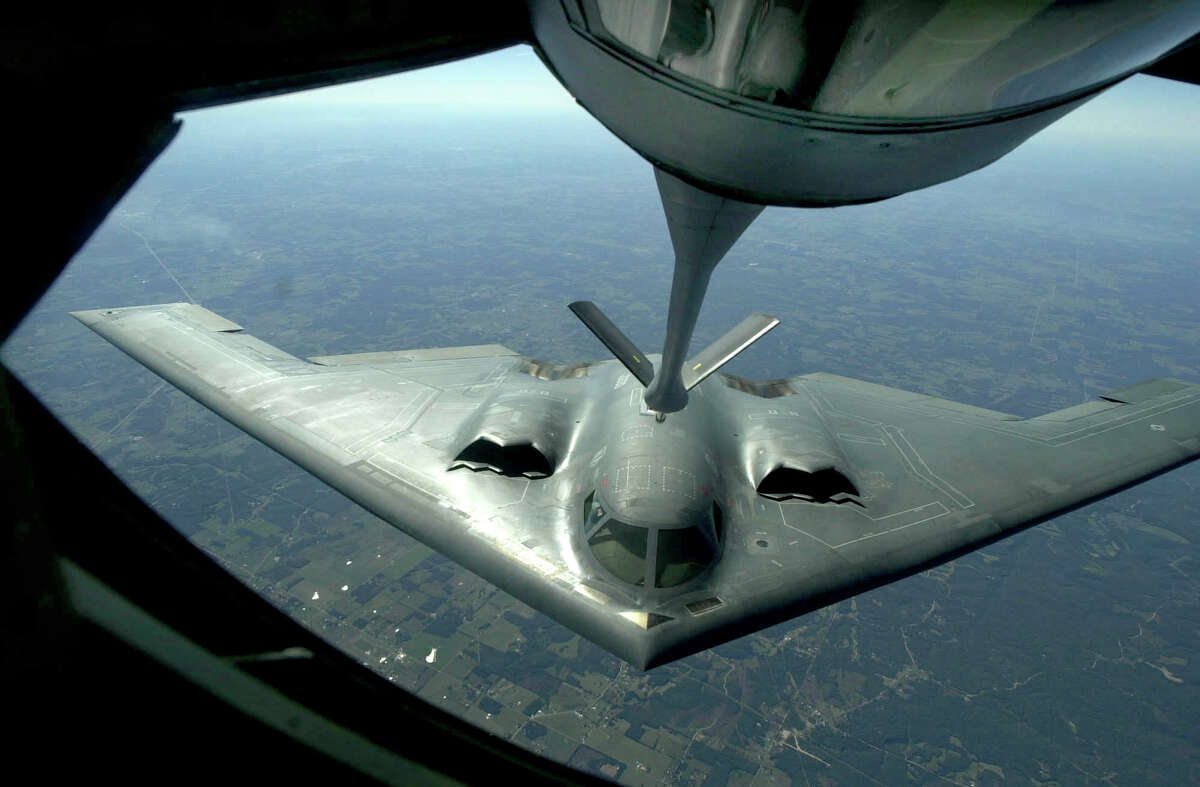 A B-2 Stealth Bomber approaches a KC135 tanker on a midair refueling operation over Missouri, Tuesday, Sept. 25, 2001. The exercise was being done by members of the Grand Forks, N.D. Air Force base. The bomber took on over 20,000 pounds of fuel. (AP Photo/Star Tribune, Richard Sennott)