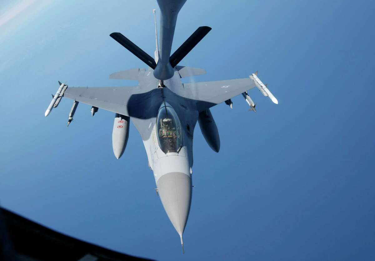 The nosepiece, top, of a KC-135 Stratotanker from the 909 Air Fueling Squadron of the 18th Wing of the U.S. Air force, based in Japan's Kadena, is connected to a F-16 Fighting Falcon from the U.S. Seventh Air Force's 8th Fighter Wing, based in South Korea's Gunsan, for aerial refueling during a joint military drills between South Korea and the U.S. over the East Sea, east of Seoul, South Korea, Monday, July 26, 2010. (AP Photo/Lee Jae-won, Pool)