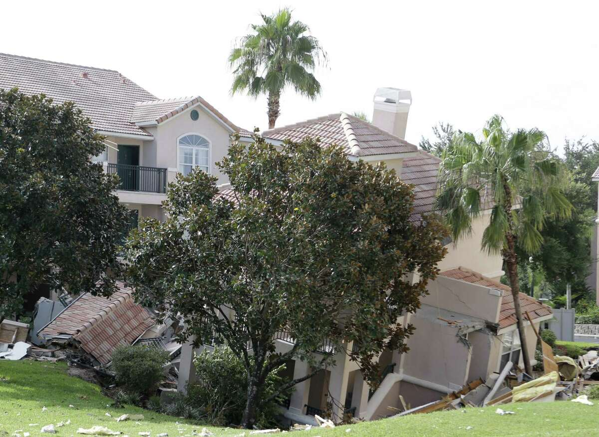 A portion of a building in Florida rests in a sinkhole, which opened up overnight and damaged three buildings.