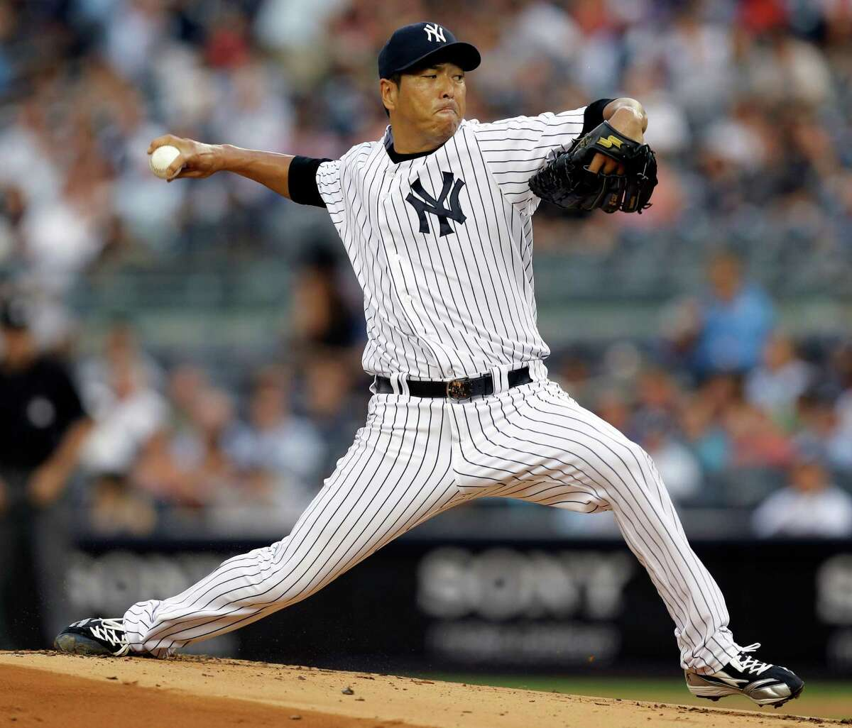 New York Yankees starting pitcher Hiroki Kuroda delivers in the first inning of a baseball game against the Los Angeles Angels, Monday, Aug. 12, 2013, in New York. (AP Photo/Kathy Willens) ORG XMIT: NYY101