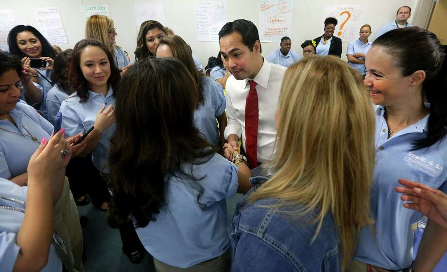 Mayor Julián Castro greets Pre-K 4 SA workers Monday at the Pre-K 4 SA South Education Center. The workers gathered for a pep rally, followed by training on the curriculum. Photo: Bob Owen / San Antonio Express-News