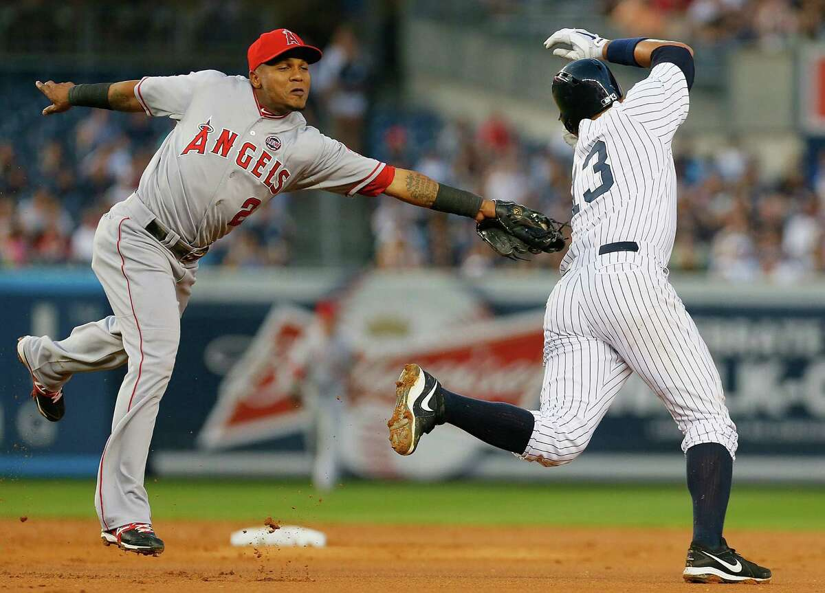 The Angels' Erick Aybar tags out the Yankees' Alex Rodriguez, who was trying to steal second base.