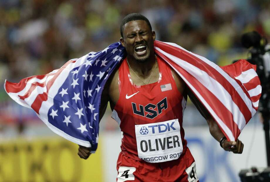 American David Oliver basks in his 110-meter hurdles title Monday at the World Championships. Photo: Anja Niedringhaus / Associated Press