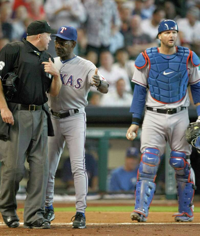 Home plate umpire Ron Kulpa, left, got an earful from Rangers manager Ron Washington, center, after throwing out catcher A.J. Pierzynski in the sixth inning of Monday's game. Photo: Johnny Hanson, Staff / © 2013  Houston Chronicle
