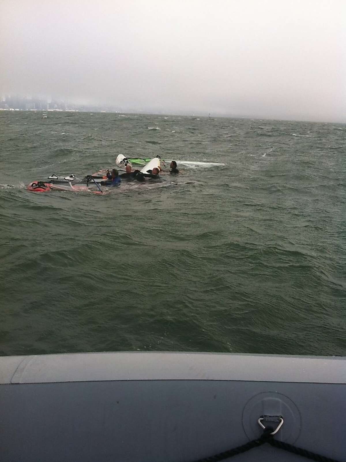 A group of windsurfers discovered and rescued a dog swimming in the bay Monday night, August 12, 2013.