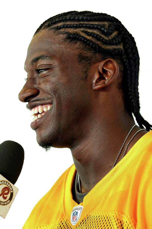 Washington quarterback Robert Griffin III, now sporting cornrows instead of dreadlocks, says there is no friction between him and coach Mike Shanahan regarding his playing status. Photo: P. KEVIN MORLEY, MBI / RICHMOND TIMES-DISPATCH