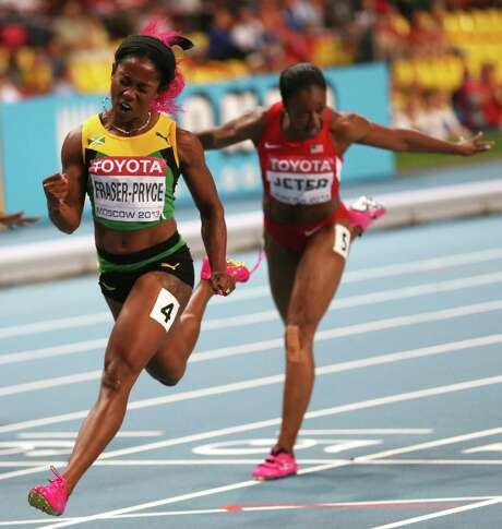 Jamaica's Shelly-Ann Fraser-Pryce wins the women's 100-meter final in a time of 10.71 seconds at the 2013 world track championships in Moscow. Photo: ADRIAN DENNIS, Staff / AFP