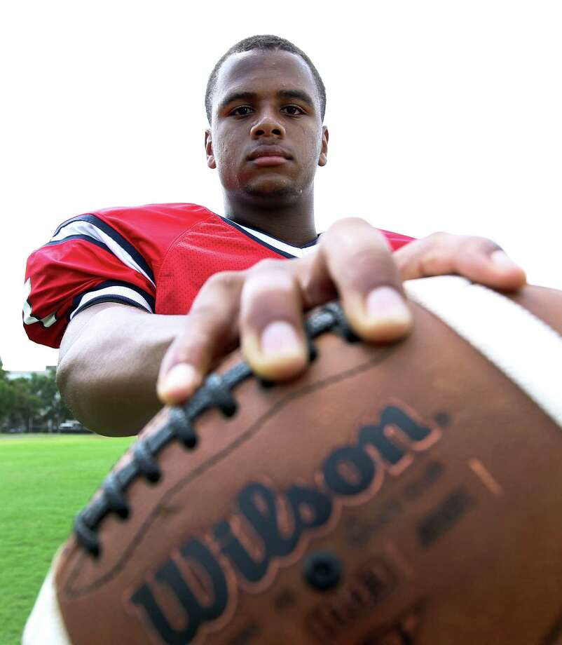 Lamar quarterback Darrell Colbert photographed after practice at Lamar High School,  Monday, Aug. 12, 2013, in Houston. Colbert led Lamar to the Class 5A Division I final as a junior. He's now committed to SMU and is a talented dual-threat quarterback who may be considered too short for the top programs but talented nonetheless.  ( Karen Warren / Houston Chronicle ) Photo: Karen Warren, Staff / © 2013 Houston Chronicle