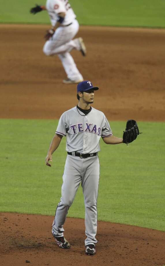 Aug. 12: Rangers 2, Astros 1  Carlos Corporan rounds the bases (in back ground) after breaking up Yu Darvish's no-hit bid in the eighth inning.  Record: 37-80. Photo: Karen Warren, Chronicle