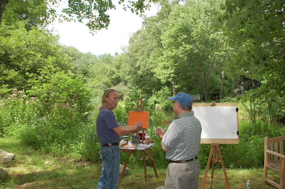 Brian Wendter, left, an instructor at Silvermine School of Art, shares his thoughts with Silvermine Guild member Richard Rerra at the third annual ArtsFest at the Silvermine Arts Center in New Canaan on Saturday, Aug. 10. Jarret Liotta/For the New Canaan News Photo: Contributed