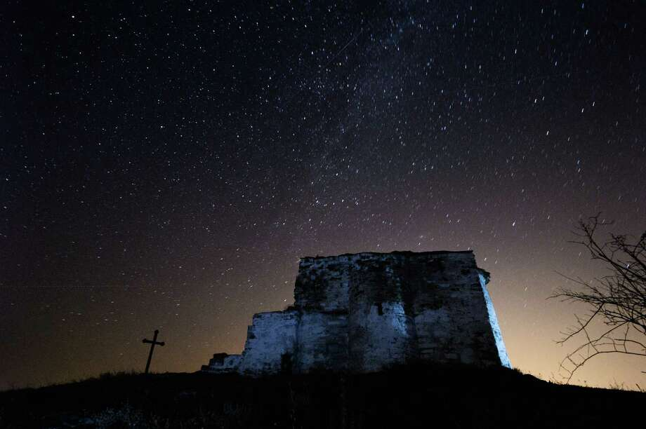 A long-exposure image showing a Perseids meteor  streaking across the night sky over St. Ioan medieval church near the village of Potsurnentsi, Bulgaria, late on Monday13. The Perseid meteor shower occurs every year in August when the Earth passes through the debris and dust of the Swift-Tuttle comet. Photo: DIMITAR DILKOFF, Getty / 2013 AFP