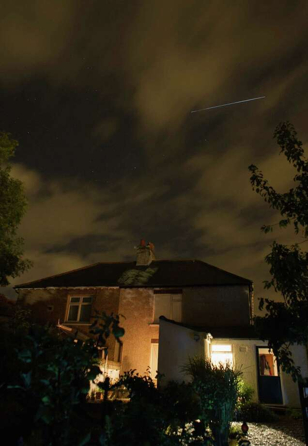The International Space Station passes over homes on Monday in Saltburn, United Kingdom. The ISS passed over on the same evening as the Perseid Meteor shower was at its peak and was visible. During the peak of the meteor shower, the rate of meteors can reach 60 or more per hour. They can be seen all across the sky as they gradually fall away from the tail of the Swift-Tuttle comet. Photo: Ian Forsyth, Getty / 2013 Ian Forsyth
