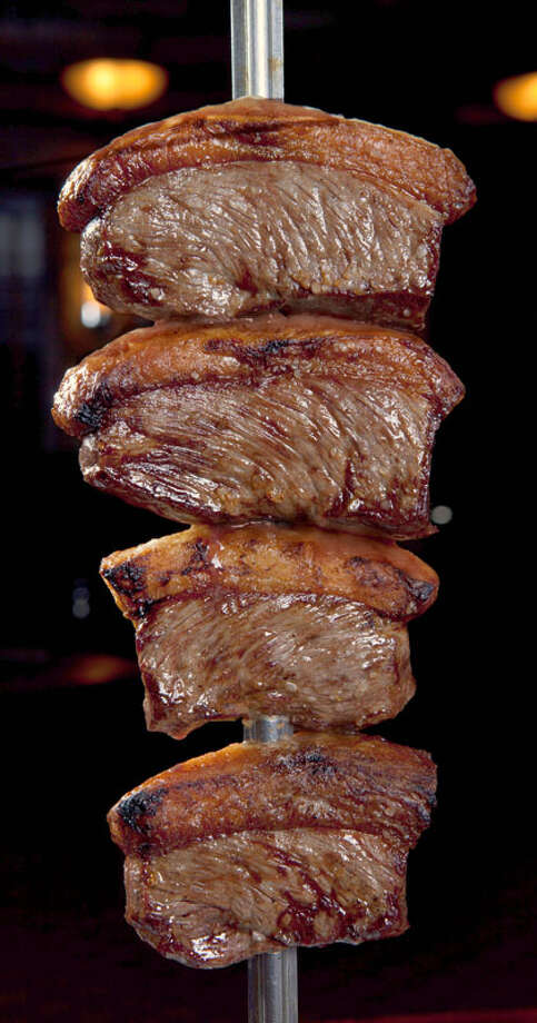 Tradicao Brazilian Steakhouse, 12000 Southwest Freeway in Meadows Place, is offering a $20 lunch menu and a $35 dinner menu featuring meats that are carved tableside For a complete list of Houston Restaurant Week restaurants, as well as menus and maps, go to houstonrestaurantweeks.com. . Photo: Courtesy Photo, Tradicao Brazilian Steakhouse
