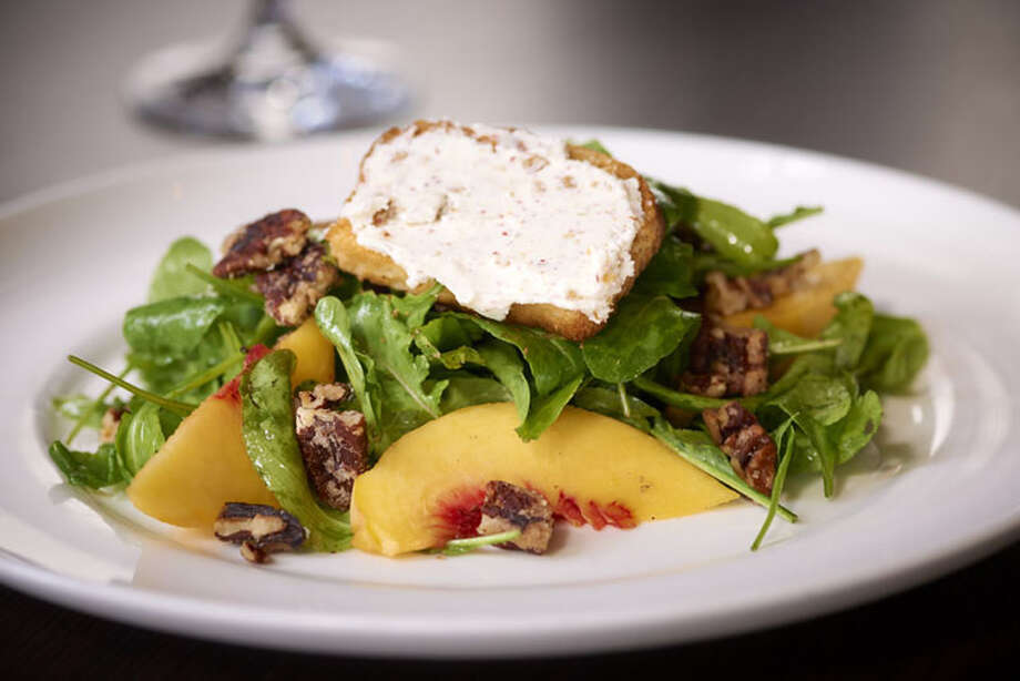 Arugula Salad with Peaches is one of the first course options at Haven.  Haven is located at 2502 Algerian Way. For a complete list of Houston Restaurant Week restaurants, as well as menus and maps, go to houstonrestaurantweeks.com. Photo: Ralph Smith