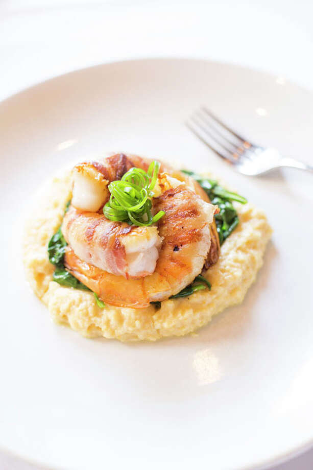 At Federal Grill, bacon-wrapped Gulf shrimp over grits and spinach with a yard egg is one of the entrees offered on a $35  three-course dinner menu.  The restaurant is located 510 Shepherd. For a complete list of Houston Restaurant Week restaurants, as well as menus and maps, go to houstonrestaurantweeks.com. Photo: Jill Hunter, 2013 Jill Hunter / 2013 Jill Hunter