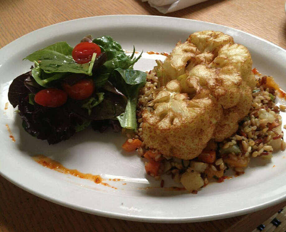 Saffron Brushed Cauliflower Steak is part of a $35 four-course vegetarian HRW menu offered at Backstreet Cafe. The restaurant is located 1103 S. Shepherd. For a complete list of Houston Restaurant Week restaurants, as well as menus and maps, go to houstonrestaurantweeks.com. Photo: Cristy Ramirez