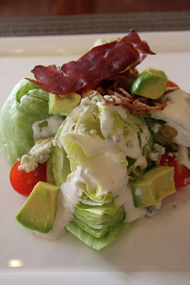 This wedge salad with  bacon and avocado is available on Quattro's $20 two-course lunch menu.  Quattro is located at 1300 Lamar in the Four Seasons Hotel.  For a complete list of Houston Restaurant Week restaurants, as well as menus and maps, go to houstonrestaurantweeks.com. Photo: Paula Murphy